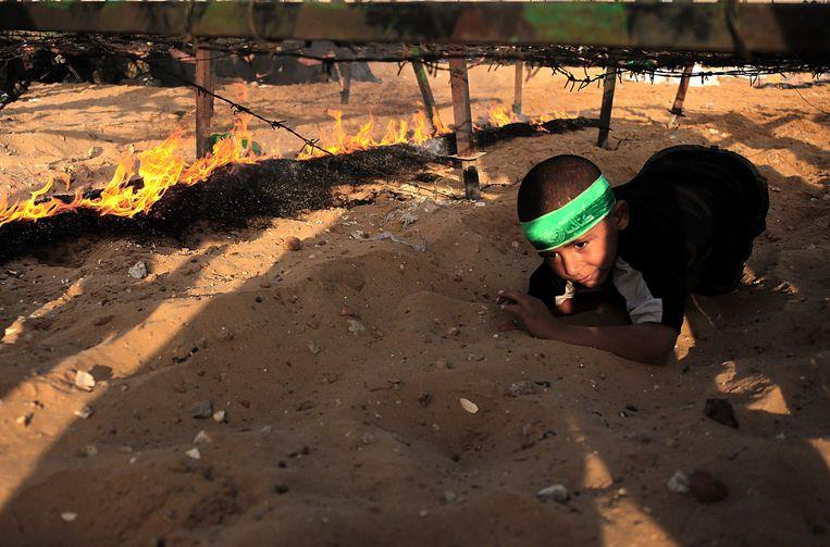 Tijgeren op een Hamas zomerkamp, juni 2015. Beeld EPA