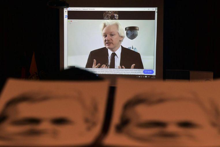 Foto's van Julian Assange. Beeld afp