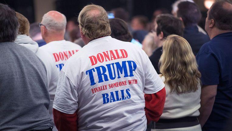 Donald Trump-aanhangers op een campagnebijeenkomst. Beeld getty