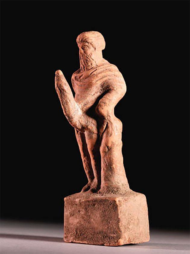 Een terracottabeeld van Priapus
