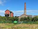 Serie treinreizen Engeland De mijn (rode gebouwen) zijn uit Redruth, East Pool Mine