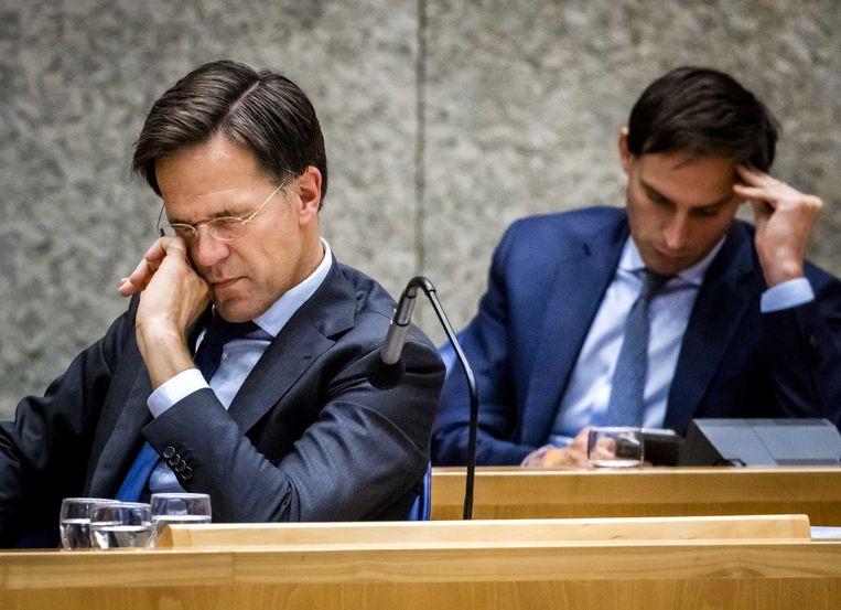 Demissionair premier Mark Rutte en Wopke Hoekstra, demissionair minister van Financiën. Beeld ANP