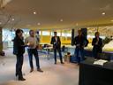 De familie Van den Eijnden proost op de koop van het Hippisch Centrum, in het midden de heer Lips van Libéma.