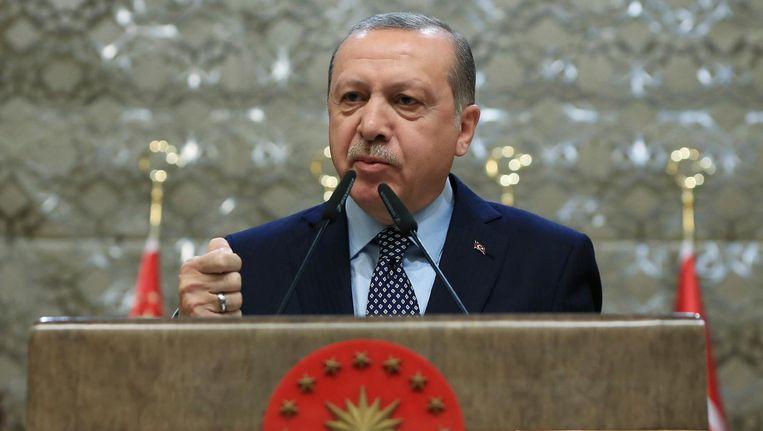 Erdogan tijdens een bijeenkomst in Ankara Beeld ap