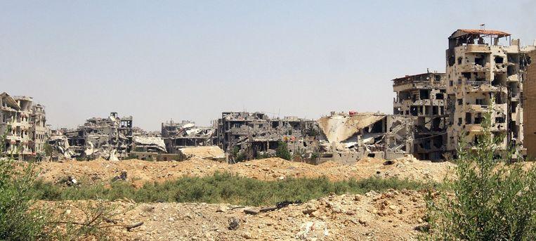 Een buitenwijk van Damascus, vorige week. Beeld anp