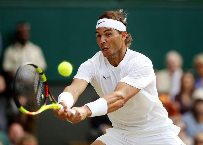 Nadal in actie op Wimbledon in 2019.