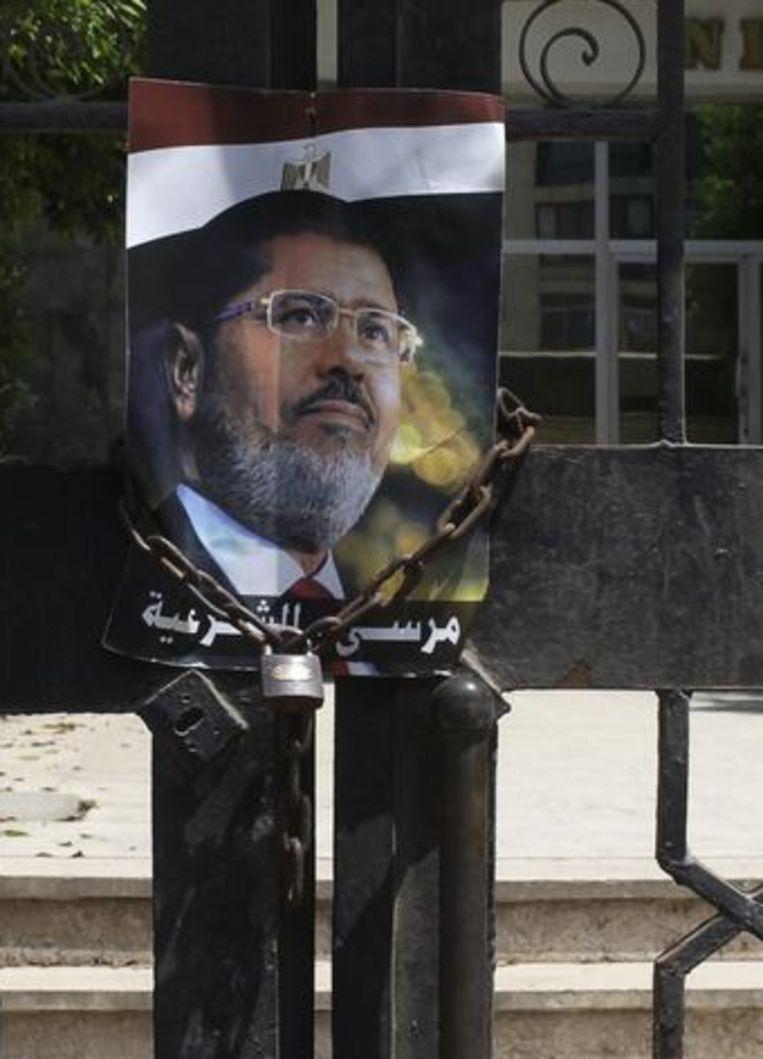 Een afbeelden van de afgezette Egyptische president Mohamed Morsi. Beeld REUTERS