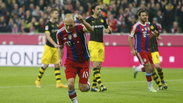 Arjen Robben schenkt Bayern vanop de stip de zege tegen aartsrivaal Dortmund. Beeld REUTERS
