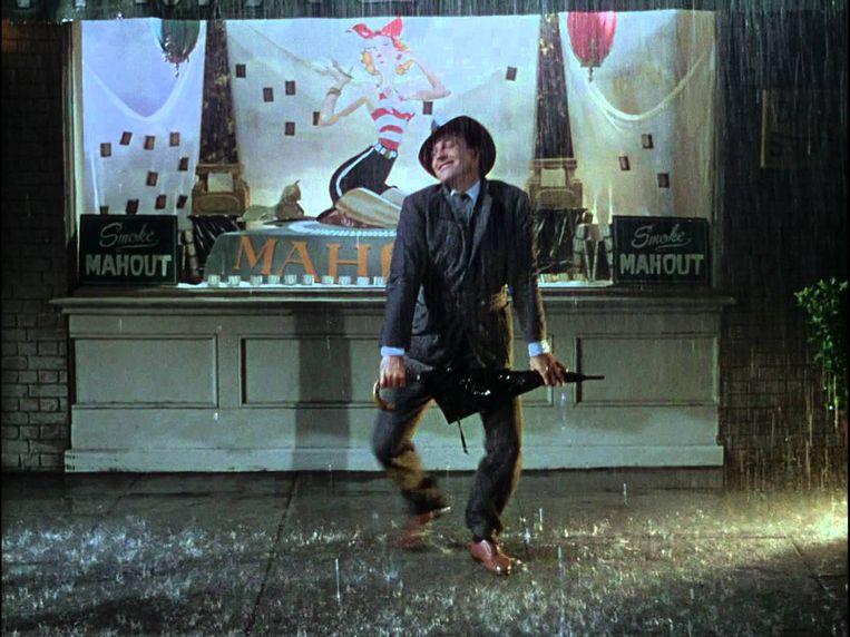Dansende Gene Kelly in 'Singin' in the Rain'. Beeld