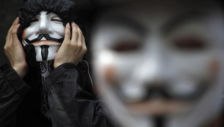 Het Guy Fawkes (of V for Vendetta)-masker in Hong Kong... Beeld reuters