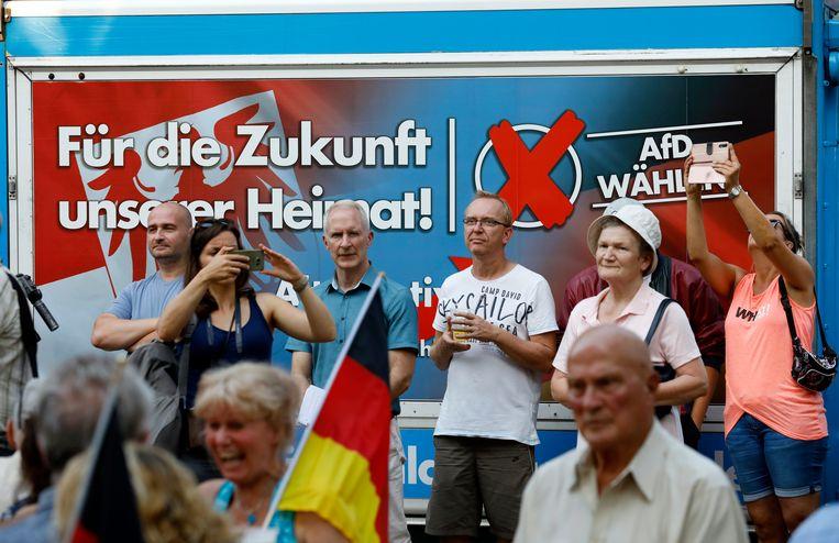 Aanhangers van AfD in Königs Wusterhausen in Duitsland. Beeld EPA