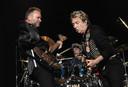 Sting, Andy Summers en Stewart Copeland van The Police tijdens hun afscheidsconcert in New York in 2008.