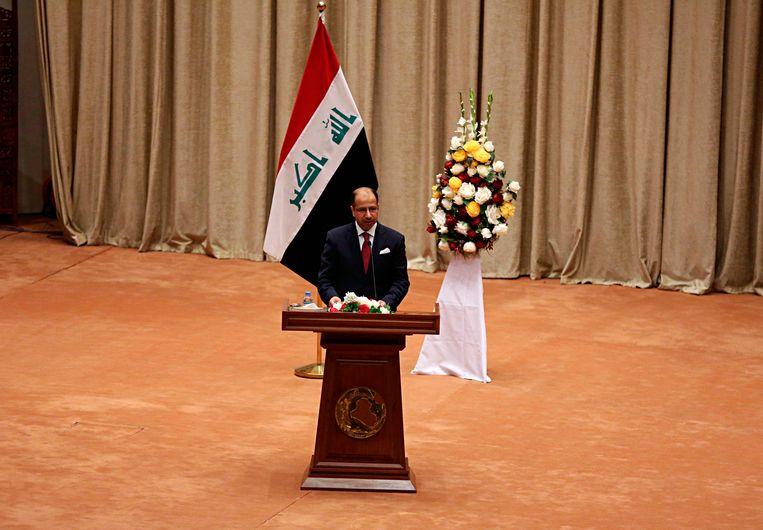 Tijdelijk Kamervoorzitter Salim al-Jabouri schorste de zitting van het parlement. Beeld AP