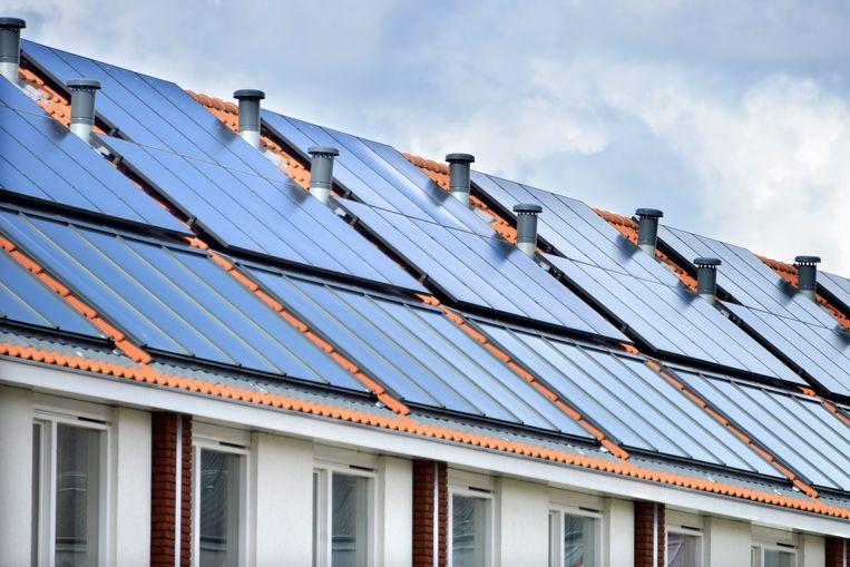 Zonnepanelen, isolatie of zonneboilers: het plan van sp.a wil vaart maken met de energiezuinige woningen in Vlaanderen. Beeld Hollandse Hoogte / Flip Franssen