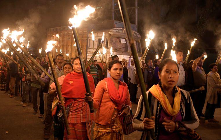 In onder meer Assam demonstreerden mensen tegen de nieuwe minderhedenwet. Beeld EPA