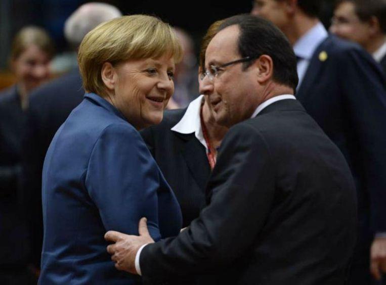 Angela Merkel met Francois Hollande Beeld afp