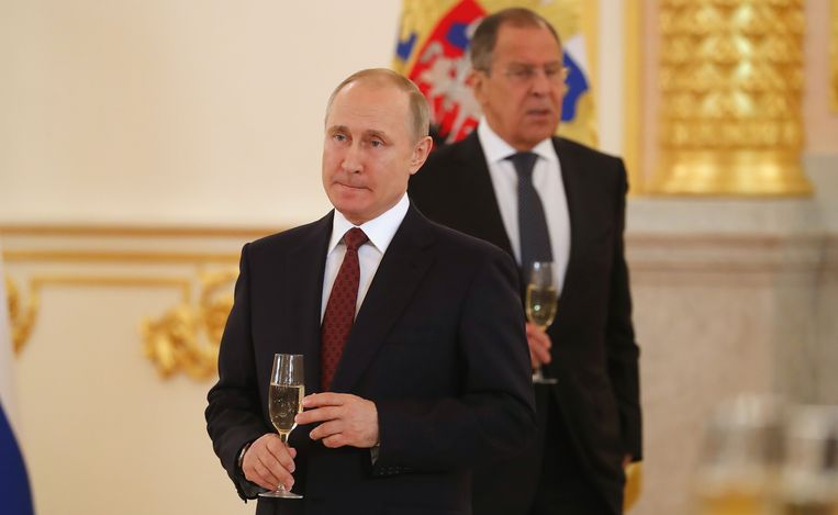 De Russische president Vladimir Poetin en de Russische Buitenlandminister Sergej Lavrov.