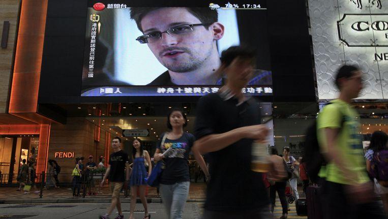 Edward Snowden is te zien op grote schermen in Hong Kong Beeld ap