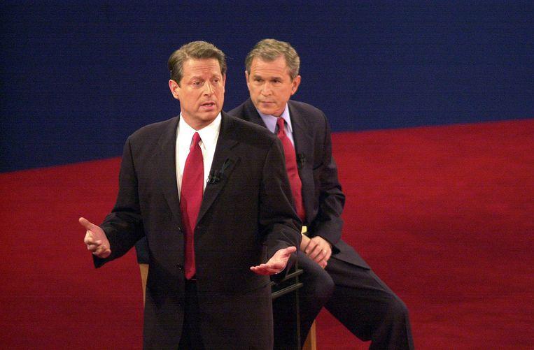 Al Gore en George Bush tijdens een presidentieel debat in 2000.  Beeld Getty Images