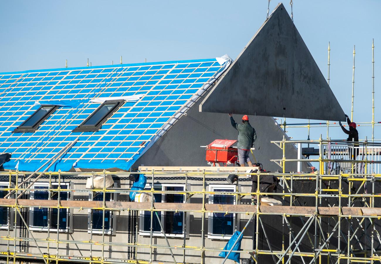 De bouw van woningen, elders in Nederland.