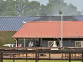 Brand in loods Strijbeek is meester, paardenstal ligt vlakbij