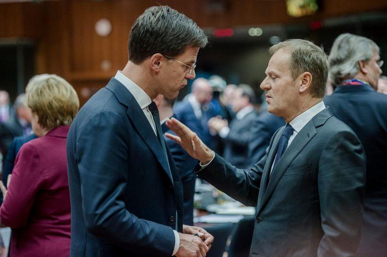 Premier Mark Rutte en President van de Europese Raad Donald Tusk tijdens de Europese Top, waar de lidstaten spreken over het associatieverdrag met Oekraïne, 15 december 2016. Beeld anp