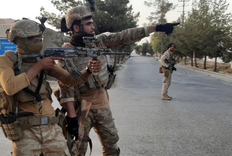 Afghaanse regeringstroepen in Lashkar Gah. Beeld AP