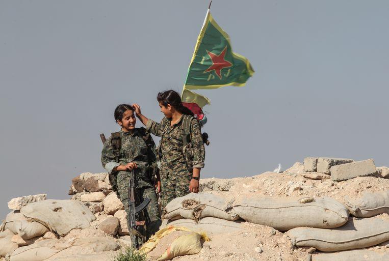 Strijders van de Syrische zustermilitie van de Turkse PKK, YPG, zijn in verschillende mate communistisch/socialistisch en grotendeels seculier.  Beeld Getty images