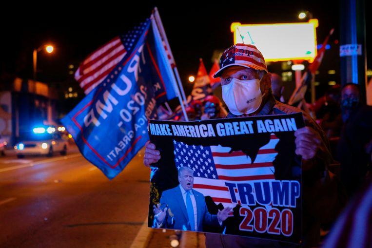De meerderheid van de Trump-aanhangers vinden dat het met de economie onder de huidige president 'geweldig' gaat. Beeld AFP