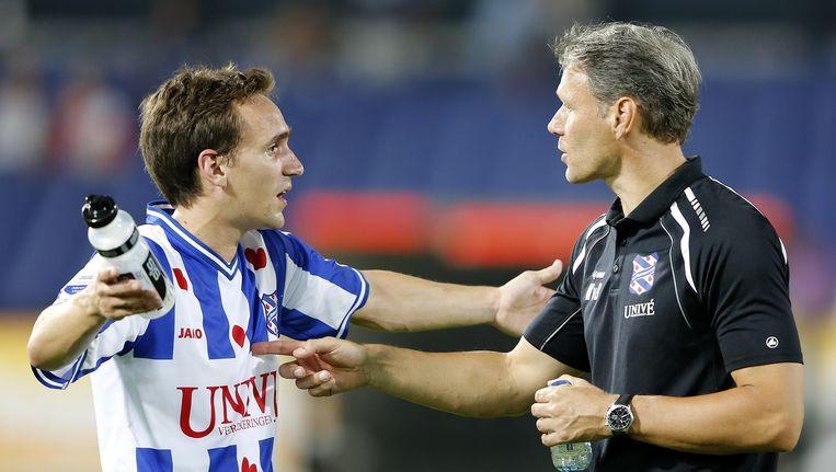 Heerenveen-speler Sven Kums (links) en trainer Marco van Basten. Beeld ANP Pro Shots