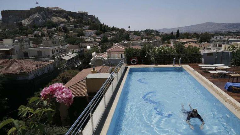 Een luxe Grieks hotel met uitzicht op de Acropolis Beeld reuters