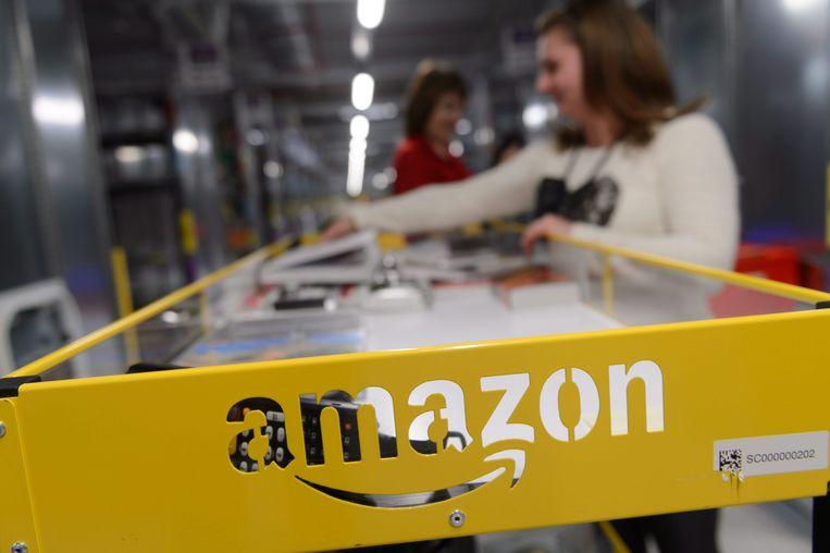 Amazon zet zwaar in op supermarkten zonder kassa's. Persbureau Bloomberg meldt op basis van ingewijden dat de webwinkelreus er de komende jaren zo'n 3000 wil openen.  Beeld EPA