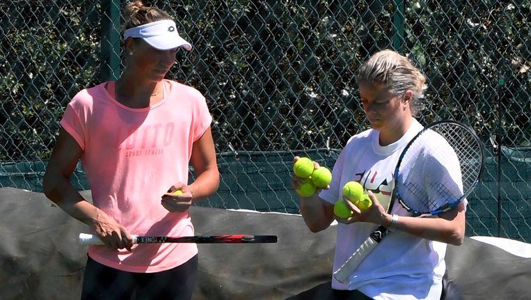 Wickmayer traint met Kim Clijsters op de All England Club. Beeld photo_news