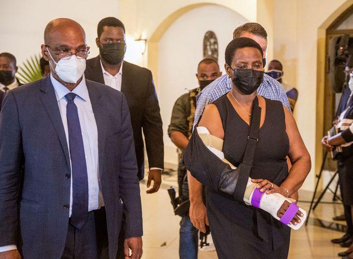 De nieuwe premier van Haïti, Ariel Henry en de weduwe van Jovenel Moïse, Martine Moïse. Zij raakte eveneens gewond tijdens de aanval in hun privéwoning.