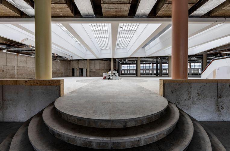 De muren van de oude bankkluizen in de kelder zijn inmiddels doorgehakt om ruimte te maken voor nog meer vierkante meters. Beeld Jean-Pierre Jans