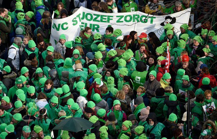 Leden van de christelijke vakbond ACV tijdens een demonstratie.  Beeld Photo News