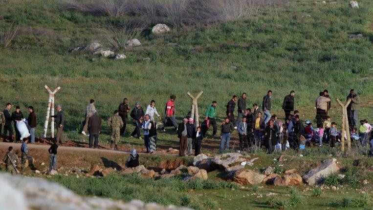 Syrische vluchtelingen bij de grens met Turkije. Beeld ap