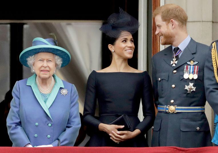 Queen Elizabeth, Meghan Markle en prins Harry.  Beeld AP
