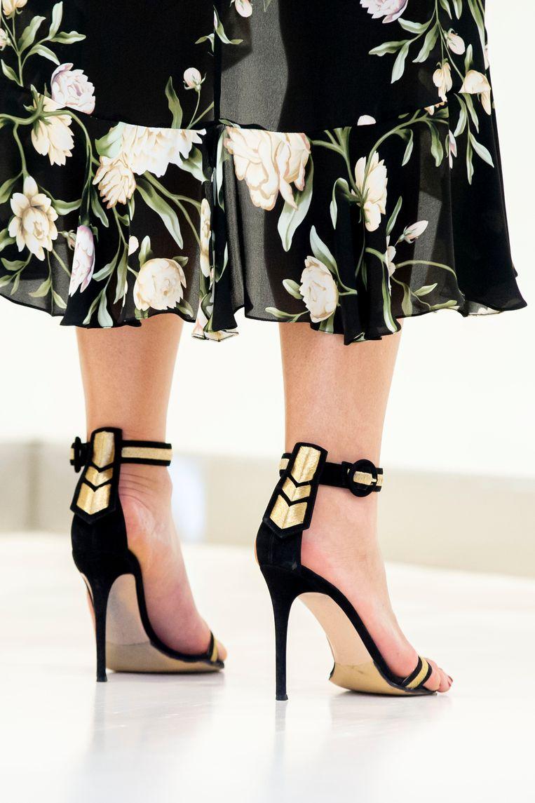 De schoenen van Maxima: hakken van 10 cm zodat haar voeten niet zo groot lijken. Beeld Getty Images