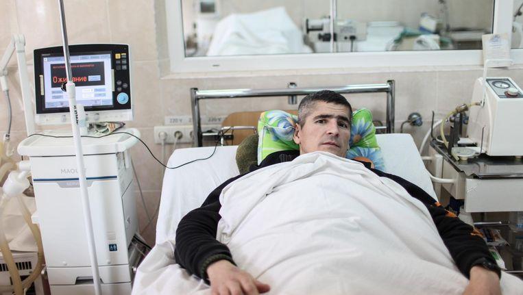 Alexey Kuprienko, 37. Commandant van de anti-sluipschuttersgroep. Zijn ammunitie werd geraakt en vier patronen ontploften. Beschadigde heup, bekken en buikholte. Mechnikova ziekenhuis. Dnipro, Oekraïne Beeld Oleksandr Techynskyi