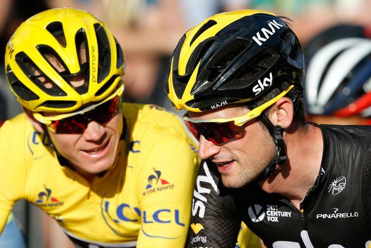 Christopher Froome (L) en Wout Poels (R) in actie tijdens de Tour de France in 2016 Beeld anp