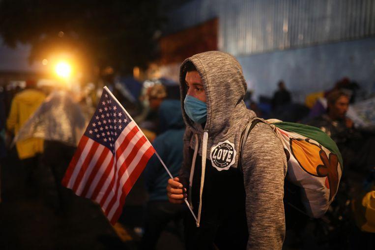 Een jonge migrant uit Midden-Amerika in Tijuana, Mexico. Beeld Felix Marquez