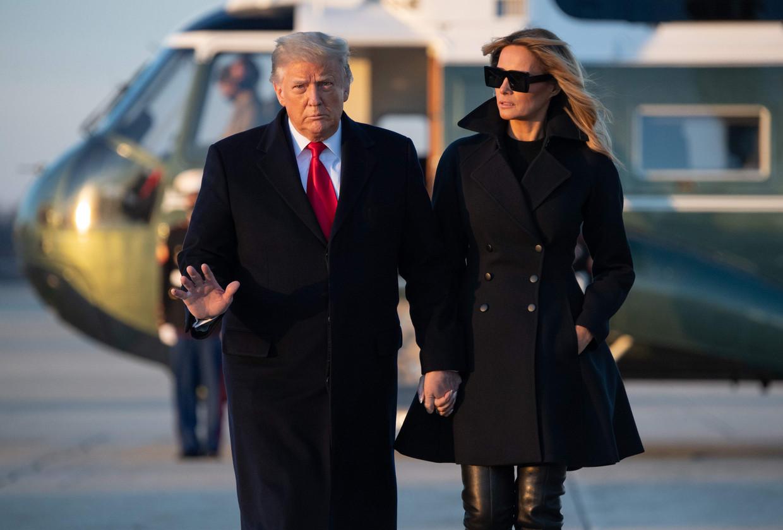 President Donald Trump and First lady Melania Trump  hebben er beiden financieel baat bij om het verhaal over verkiezingsfraude levend te houden. Beeld AFP