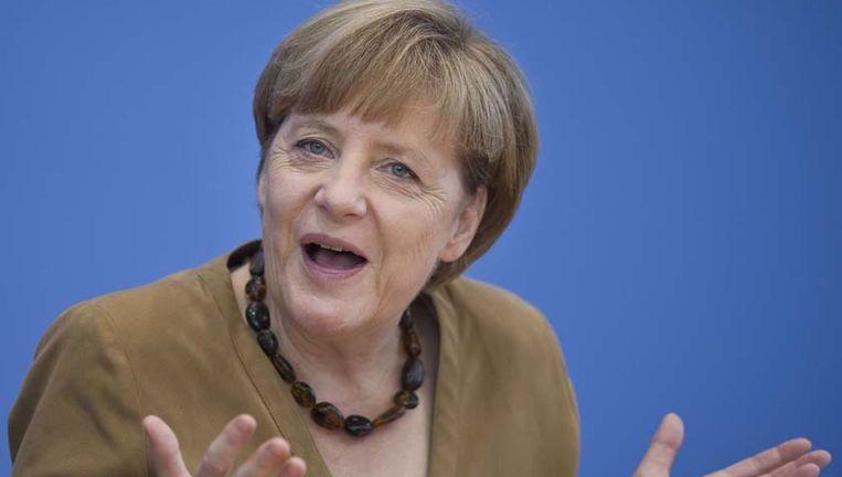 Merkel neemt de uitnodiging in beraad. Beeld PHOTO_NEWS
