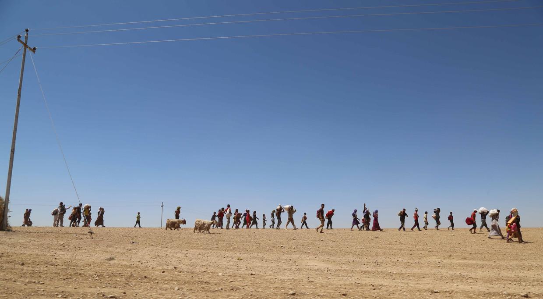 Een tafereel van bijna bijbelse proporties: tienduizenden yezidi's op de vlucht door de woestijn in Syrië, 9 augustus 2014.