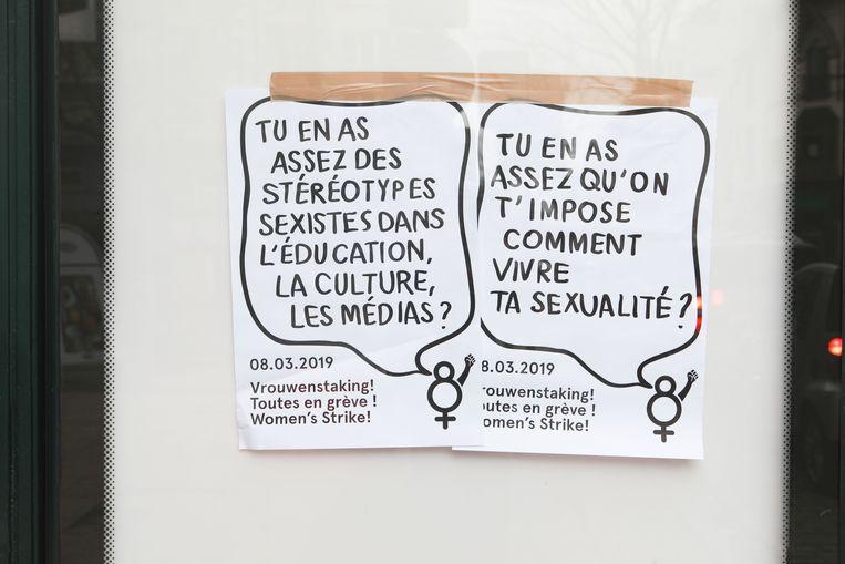 Een poster die de algemene vrouwenstaking van komende vrijdag aankondigt.  Beeld BELGA