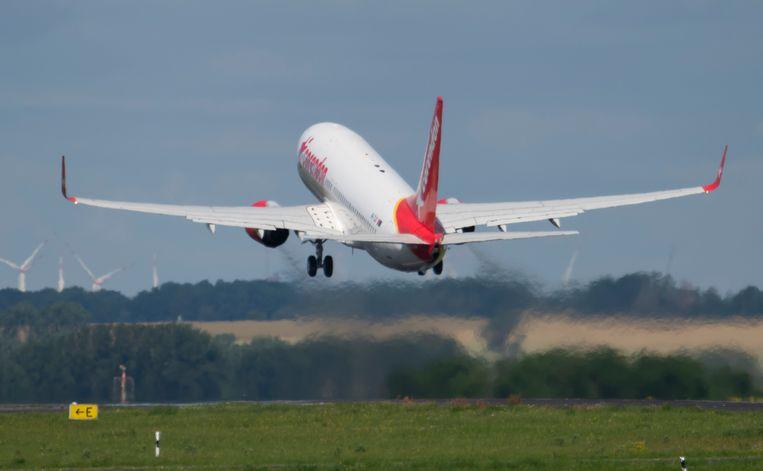 Een vliegtuig op weg naar Rhodos voor een testreis.  Beeld AP