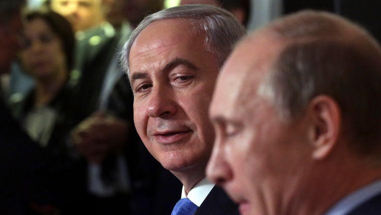 De Israëlische premier Benjamin Netanyahu en de Russische president Vladimir Poetin tijdens een bijeenkomst in mei van dit jaar Beeld REUTERS