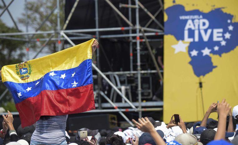 Venezuela Aid Live, opgezet door miljardair Richard Branson, lokt mensen die Juan Guaidó steunen. Beeld AFP