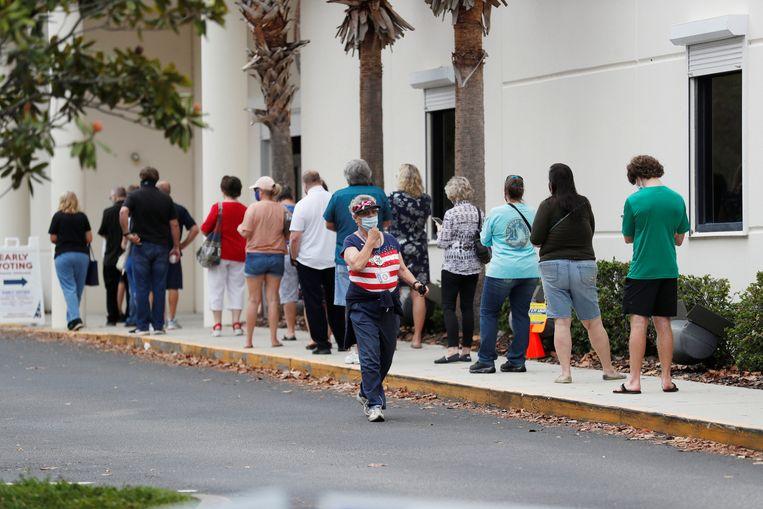 Veel kiezers hebben al gestemd en hadden daar vaak lange wachtrijen voor over zoals in Florida. Ook in Utah, Californië en Wisconsin is volop gestemd. Beeld REUTERS